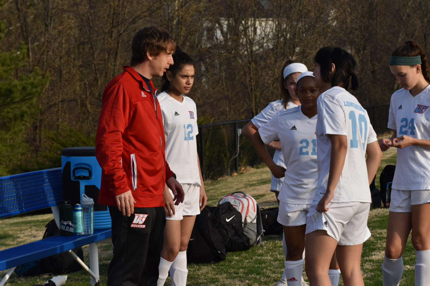 JV soccer coach Darren Rahe informs his players what position they will be playing. Rahe taught the girls about their role on and off the field. ¨If you approach practice each and everyday to be the best that you can be, you can use that same mental focus for anything that you do in life,¨ Rahe said.
