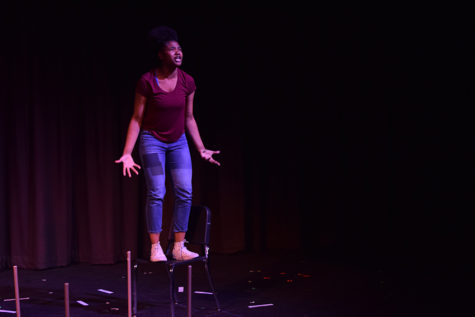 Gesturing to the audience with open arms, junior Aaliyah Weston plays the character Two in one act play