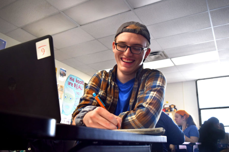 """Working on his novella before the approaching publishing date, senior Hayden Riehl hopes to grow both his understanding of the world around him and the world's understanding of him. """"I find writing for storytelling to be incredibly therapeutic, just from some of the stories that people have written in class that I've [seen],"""" Riehl said. """"It was them literally working through a trauma that they've had in the past or something that they're trying to get their own heads wrapped around. Stories can do that. They can help you navigate a sea of your own thoughts."""""""