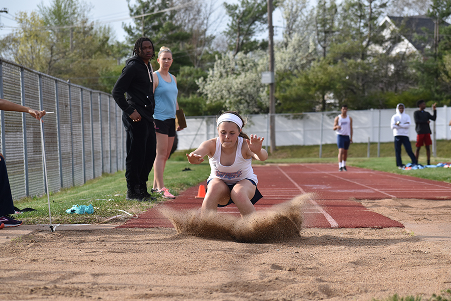 "Landing her triple jump, freshman Laurel Rakers competes in a track meet against Parkway South, April 10. Rakers worked with both coaches and older teammates to perfect her jumps and cites senior Tess Allgeyer as one of her role models on the team. ""I just started this year. I really liked long jumping, and my coach wanted me to try the triple jump. I loved it,"