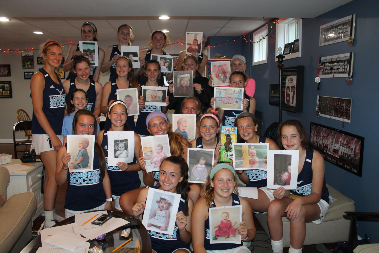 "Arriving at senior Dani Meyer's house for a team dinner, coach Annie Wayland is greeted with a surprise baby shower. The team each printed off their baby pictures, and included one of Wayland as well. ""I'm so overwhelmed with the love, support and generosity of my soccer girls and families. I feel so lucky and blessed to have them in my life. It touched my heart more than they will ever know, and it's a day I will never forget,"" Wayland said."