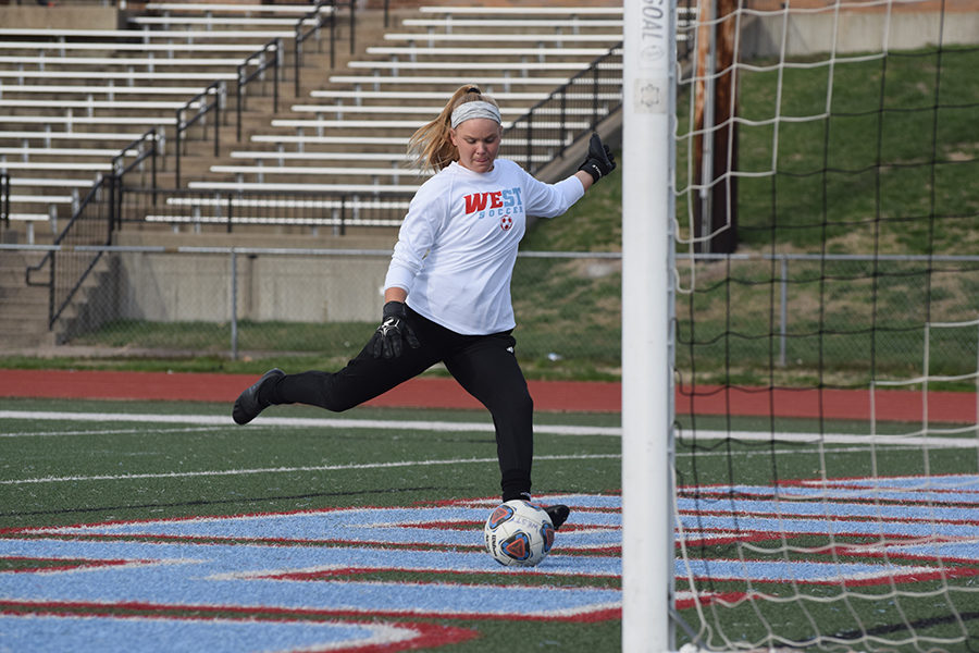 """Warming up before the game against Fort Zumwalt East, senior Erika Anstine, the varsity goalkeeper leads her team to a one to zero victory. As of April 11, of the seven games played [and won], Anstine has only had four goals scored against her. """"I'm really excited for this season, I think there is a lot of skill on this team and we are off to a really great start, being undefeated. I think this season will definitely be a good one and I'm excited to see where it goes,"""" Anstine said."""