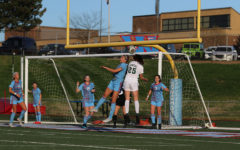 "In a soccer game against Nerinx hall, senior Ashton Manwill goes up for a head ball off a corner kick. The girls varsity soccer team beat Nerinx Hall 2-1. ""I was really excited because in all my years of playing Nerinx it was the first time we have ever beat them, which was just the best feeling,"" Manwill said."