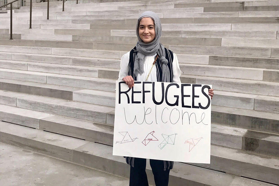 Standing+in+front+of+the+Missouri+capitol+building%2C+sophomore+Ulaa+Kuziez+shows+her+support+for+Syrian+refugees.+Kuziez+visited+Jefferson+City+with+the+Council+of+American+and+Islamic+Relations+%28CAIR%29.+%E2%80%9CThere+are+definitely+some+negative+aspects+to+standing+out%2C+being+a+Muslim+immigrant+in+a+majority+white+high+school%2C%E2%80%9D+Kuziez+said.+%E2%80%9CAt+times+it+can+get+a+little+uncomfortable+or+a+little+awkward%2C+but+I+choose+to+be+unapologetic+about+my+identity+and+about+being+a+Muslim%2C+Syrian-American+woman.%E2%80%9D