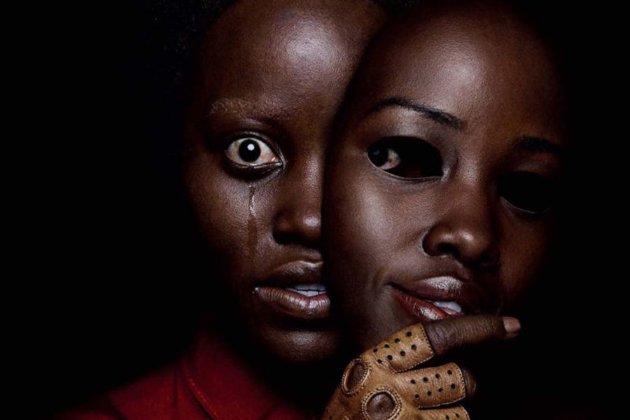 Lupita+Nyong%27o+as+Red+in+a+promotional+poster.+%22Us%22+grossed+%2429.1+million+on+its+first+day+in+box+office+sales.