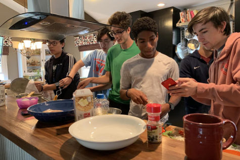 "Seniors Stephen Zhao, Andrew Li, Caleb Canatoy, Joaquin Rendon and Noah Wright work in teams to create tasty dishes for a cooking competition, judged by seniors Maria Newton and Harper Stewart. The boys, also including seniors Tony Galanti, Paul Gipkhin and Umer Mallick, raced against the clock and each other to avoid the losers' punishment of having some hair waxed off. ""Having a friendly competition drove me to try my hardest so that my friends could be impressed,"" Li said."