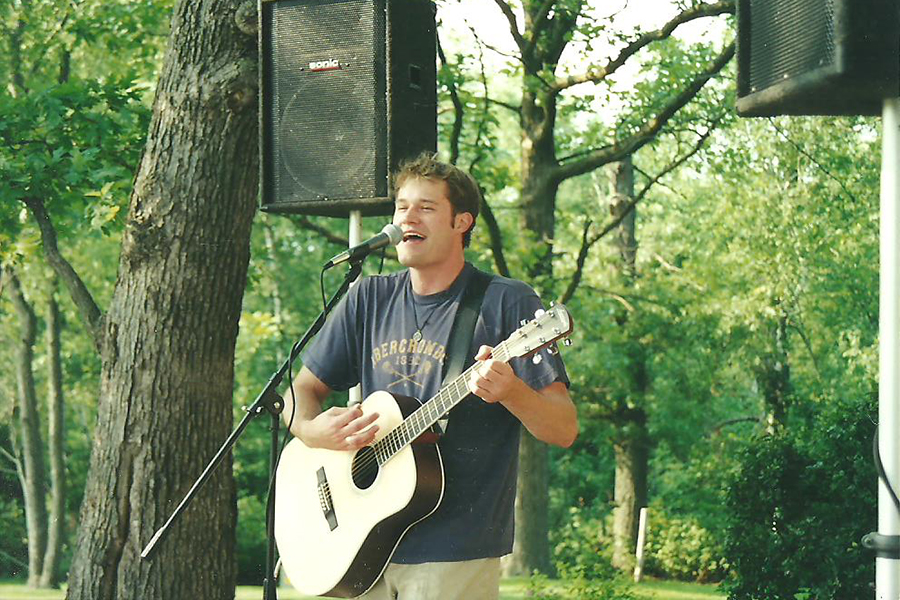 "History teacher Aaron Bashirian plays a gig at a local fair in his hometown of Elroy, Wis. July 1998. ""I would say [my music] is pop-y,"" Bashirian said. ""It's a happy-go-lucky sort of pop. There are some rock elements to it but it really is just feel good, fun music."""