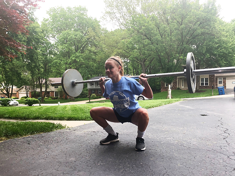 """Sophomore Claire Hardy back squats 115 pounds. Claire has been weight lifting to get stronger for soccer and to stay in shape. """"If you look back and your numbers are all the same, then you feel like you have done nothing, but it's good to look back and see your improvements,"""" Hardy said."""