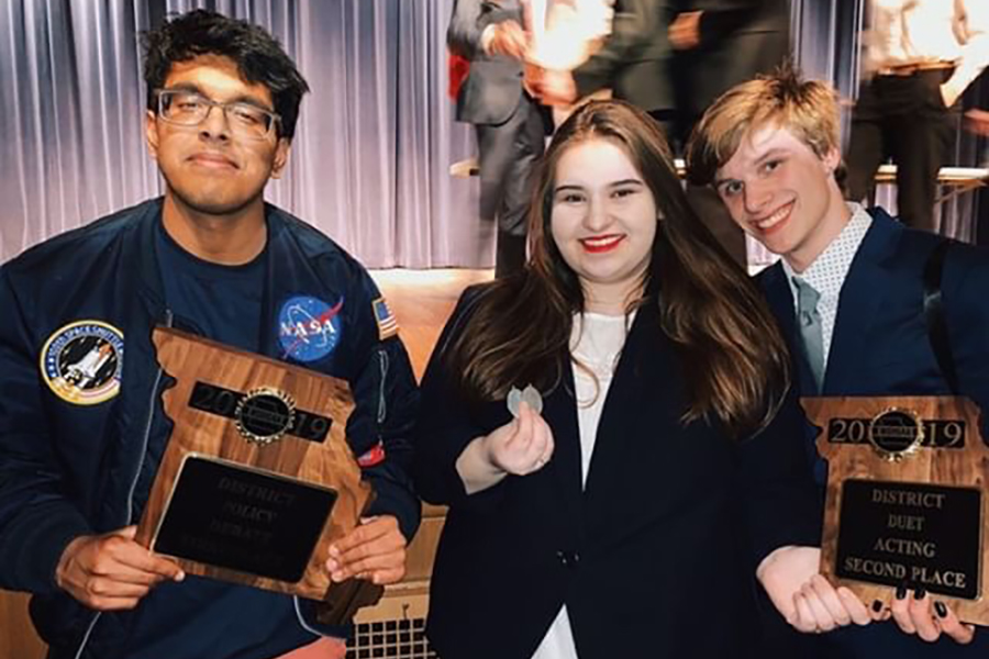"Seniors Gokul Venkatachalam, Kristina Humphrey and Luke Donovan pose with their plaques from the district tournament. Venkatachalam will go to nationals in the ""Policy Debate"" event and Humphrey and Donovan will compete in the ""Duo Interpretation"" event. ""I've never been to the national tournament before,"" Humphrey said. ""I know it's very competitive because you're competing against a bunch of national qualifiers. I hope we can do well, and I doubt we'll make the final stage, but we're going to try as hard as we can."""