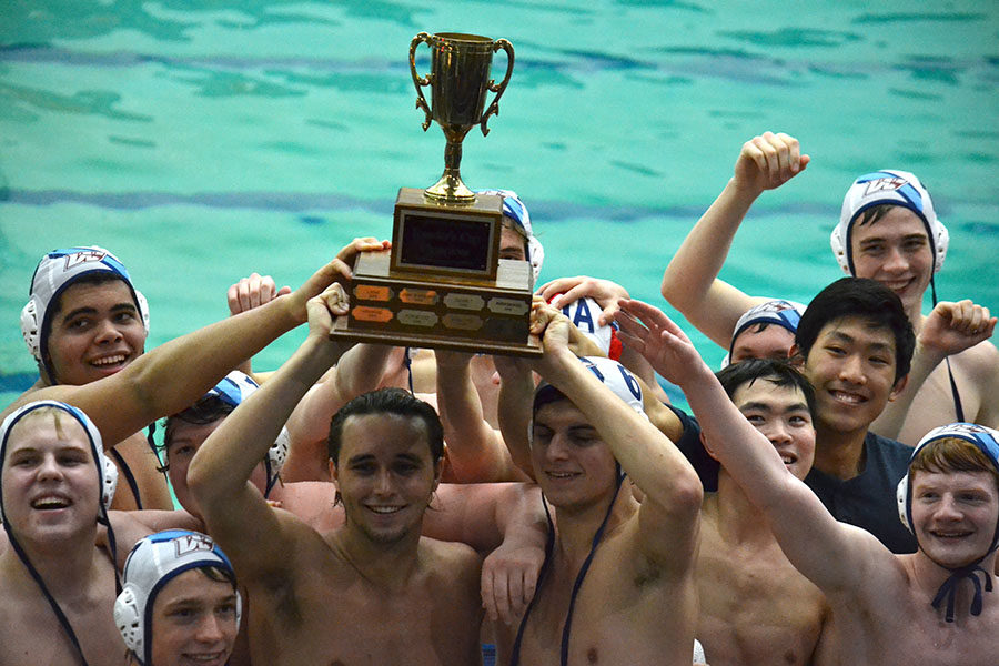 The+varsity+water+polo+teams+celebrates+winning+the+Founders+Cup%2C+a+tournament+hosted+by+Ladue+High+School+April+6.+The+team+competed+against+five+other+teams%2C+ultimately+defeating+Ladue+20-2+for+the+title.+In+addition%2C+the+varsity+water+polo+team+placed+second+at+state.+%E2%80%9CWinning+the+Founders+Cup+was+definitely+a+highlight+of+the+season.+The+weeks+prior%2C+we+were+having+trouble+running+a+smooth+offense%2C+but+during+this+tournament%2C+we+%E2%80%98clicked%E2%80%99+and+figured+things+out.+In+the+final+game%2C+there+was+a+lot+of+energy%2C+and+we+played+cohesively%2C+which+led+us+to+the+win%2C%E2%80%9D+sophomore+McKay+Morgan+said.+