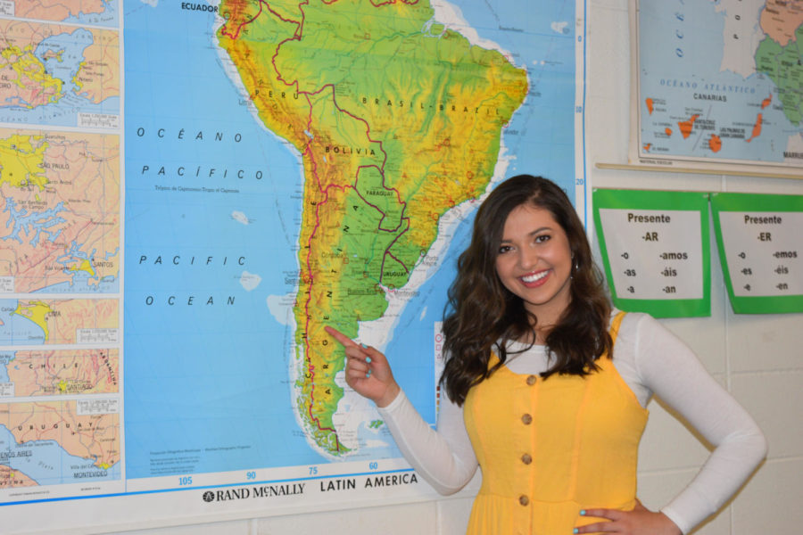 """Junior Savannah Araya points to Chile on a map of Latin America. Araya has dual citizenship in the United States and Chile; she visits Chile every other summer with her family. """"One of the big things that we do is La Cueca; it is a ritual dance that we do with our whole family. We [also] go hiking with our donkeys,"""" Araya said. """"Chile is kind of split up because the equator goes right between it, so one side of it is hot and then the other side is cold. You can go see penguins or you can go see camels, so we do a lot of outside stuff."""""""