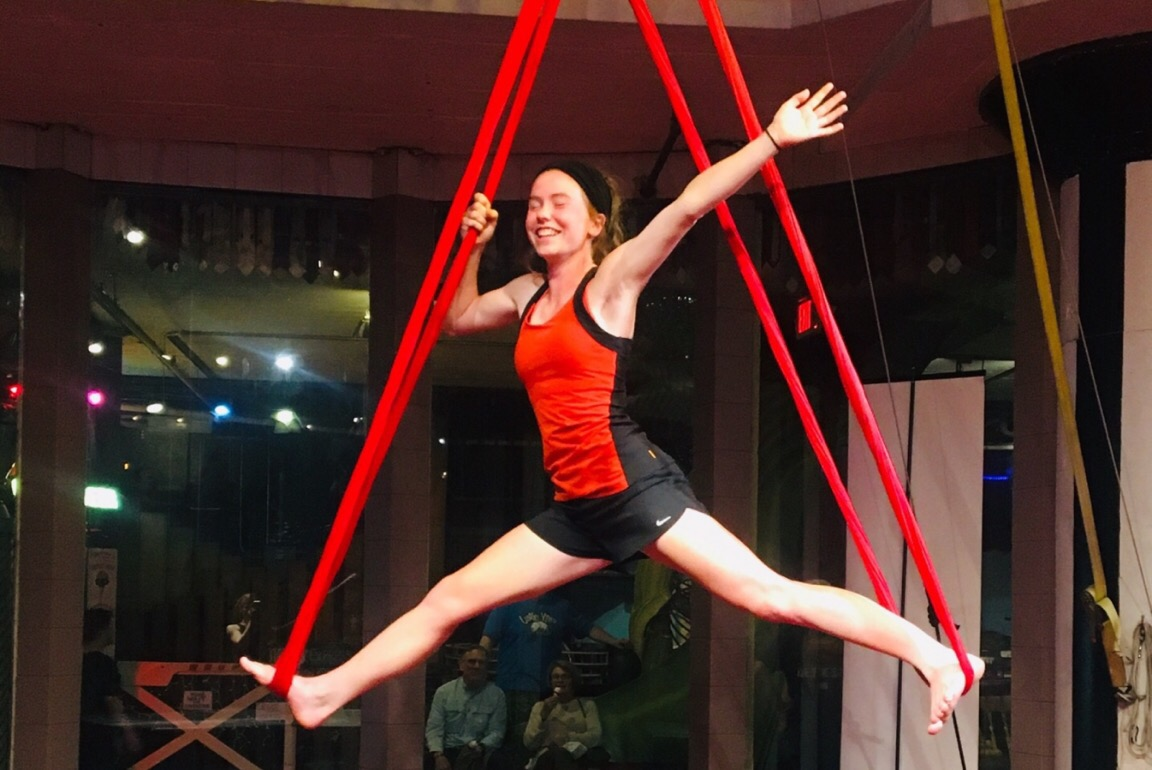 "Making her way into the splits on silks, junior Callie Hummel begins to pose for the circus class. Circus Harmony at the City Museum offers classes between practices and performances. ""We tried a hoop first that was hanging down from the ceiling, and then we did silks,"" Hummel said. ""It was something different and really fun."""