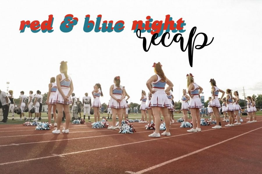 Varsity cheerleaders watch the game from the sidelines.