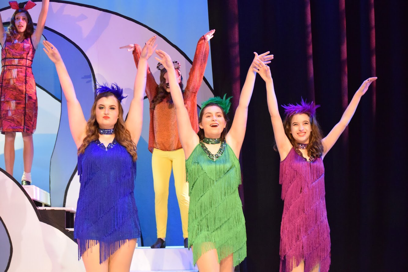 "Performing in the musical ""Seussical,"" sophomore Anna Stephens dances and sings on stage in a purple dress alongside two other performers, playing one of the Bird Girls, a supporting lead role. Stephens was cast in the production through a local company called Spotlight Productions. ""I loved getting to be sassy and have fun with my friends on stage. The Bird Girls helped narrate throughout the story and I loved the costumes very much,"" Stephens said."