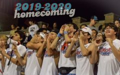 The student section cheers loud at the Homecoming football game on Sep. 13.