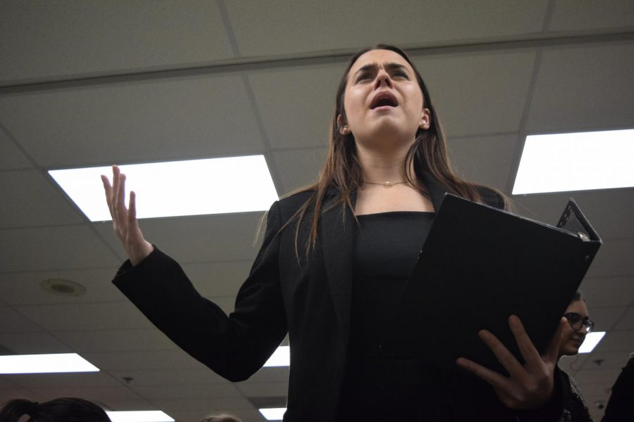 "Before the first round of the tournament, junior Grace O'Connor rehearses her Program Oral Interpretation (POI) performance at the Randy Pierce Winter Classic at Pattonville High School Dec. 7, 2018. Competitors create a performance using various published works of prose, poetry and drama around a central theme. ""It hurts when people don't listen to your piece because you spend so much time working on it, and you do really pour your heart into it,"" O'Connor said. ""When people dismiss it simply because of your gender, it's so heartbreaking and for a lot of people it's not worth it [to continue competing]. It's not worth the emotional labor and the aspects of just not being heard because of what you look like or what your gender is."""
