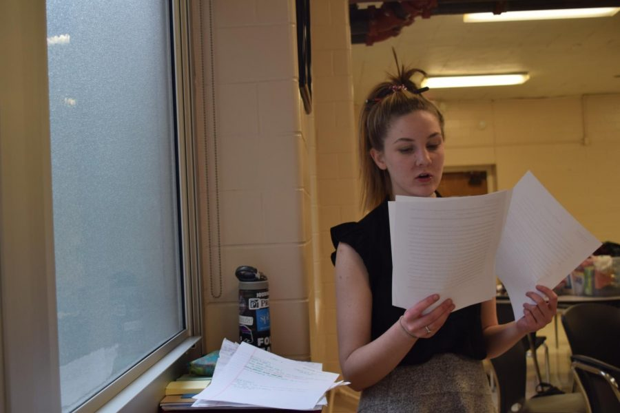 Reviewing notes, junior Kathryn McAuliffe prepares for the MSHSAA speech and debate district tournament at Brentwood High School March 1.