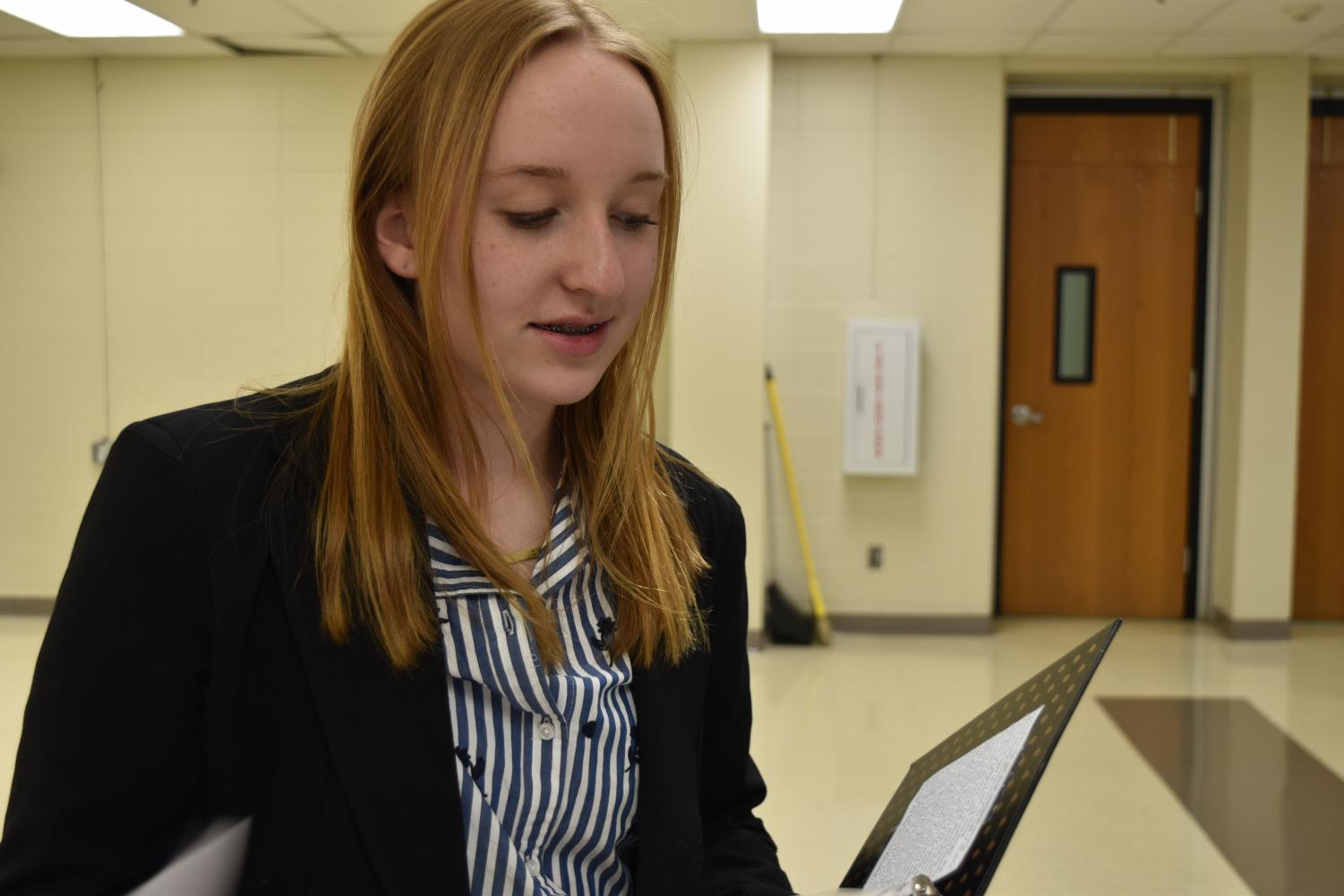 "Junior Laura Young refines her speech after receiving feedback from teammates. Young and her debate partner, junior Zoey Womick (not pictured), placed second in the Greater St. Louis Conference in Public Forum Debate for the 2018-19 season. ""Being a girl in debate is sometimes intimidating because when you go up against really good teams that are two males or even just one guy, they oftentimes have more of a reputation than the really excellent all-girl teams do,"" Young said. ""A lot of events are also male-dominated, which is also extremely intimidating because they come off as very charismatic and have so much more of a reputation that it's just really scary to go up against them."""