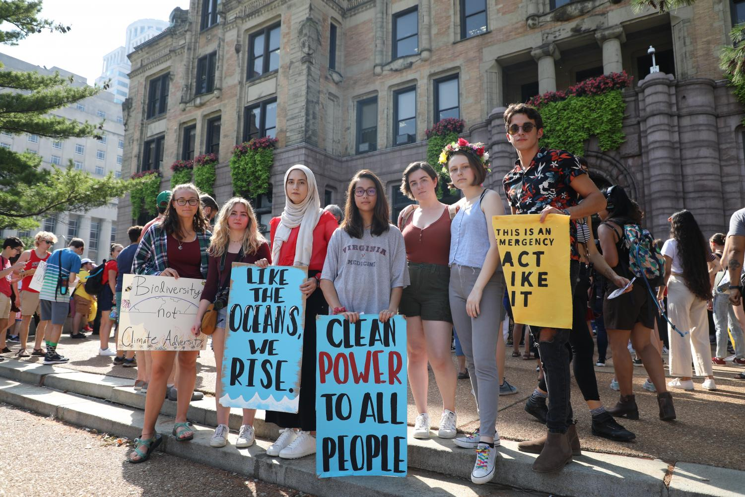 "Holding hand-made signs in front of St. Louis City Hall, sophomore Maura Collins, senior Sabrina Bohn, juniors Ulaa Kuziez, Abby Caudill, Zoe Rutledge and Gillian Davis and senior Jack Carusa protest against inaction on environmental crises during school hours Sept. 20. Kuziez participated in the organization of the climate strike to plan out the logistics of the walkout and facilitate greater high school involvement. ""The climate crisis is obviously the biggest threat to our lives and to our future. I still don't think many people are treating it as a crisis, but it's imminent, and it's already happening right now,"" Kuziez said. ""A lot of the things [the speakers] were talking about was new information, so I treated it as a learning experience so I could become more educated about the issue. One of the speakers talked about how the climate crisis is fueled by capitalism and greed from fossil fuel companies who care about profits [more than] people. Her speech was talking about how it is important to think about the climate crisis as an extension of these capitalistic, colonial systems."""