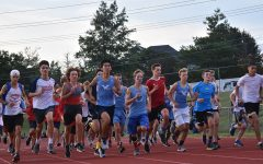 """During Red and Blue night on August 27  the boys' Cross country team came together for their first race of the season. Before racing against each other, the team captains divided the teammates into red, white and blue teams. """"My teammates definitely motivate me to get better, whether it's through giving encouragement or making plans to train together,"""" senior Dawson Ren said.  """"I'm really glad to have such awesome teammates, and I've grown really close to them. Racing with them is another joy, because we can spur each other on during competition."""""""