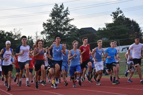 "During Red and Blue night on August 27  the boys' Cross country team came together for their first race of the season. Before racing against each other, the team captains divided the teammates into red, white and blue teams. ""My teammates definitely motivate me to get better, whether it's through giving encouragement or making plans to train together,"" senior Dawson Ren said.  ""I'm really glad to have such awesome teammates, and I've grown really close to them. Racing with them is another joy, because we can spur each other on during competition."""