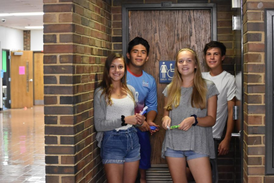 """Highlighting the importance of access to feminine hygiene products for all, sophomores Anna Newberry, Mira Nalbandian, Santi Lugo and Mason Paul model their future club plans. Newberry believes inaccessibility of products can lead to health issues, embarrassment and even a lack of belonging. """"I want to stock bathrooms with feminine hygiene products to help reduce stigma and embarrassment that can come with having a period,"""" Newberry said. """"I know [I] haven't come to school before because I was embarrassed and wanted to go home, or I was in pain or didn't have what I needed to have. I feel like everyone has a right to be here, and I feel like no one should feel like they can't come to school."""""""
