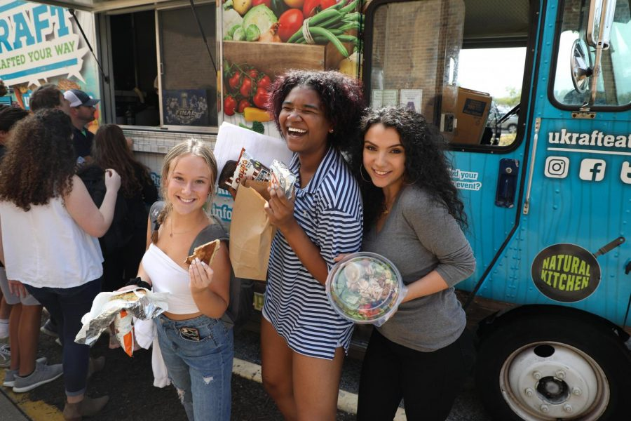 Getting+ready+to+bite+into+food+truck+menu+options+from+UKRAFT+Eats%2C+junior+Claire+Middleton+and+seniors+Aaliyah+Weston+and+Reema+Alhachami+learn+about+the+logistics+of+owning+a+food+truck+from+owner+and+operator+Matt+Ratz.+Marketing+I+teacher+Holly+Weber+brought+in+Ratz+to+guide+students+as+they+create+their+own+food+trucks+for+their+class+projects%2C+and+inspire+them+to+set+and+accomplish+goals.+%22There+are+so+many+different+options+of+what+you+can+eat%2C+or+what+%5Bthe+truck%5D+can+look+like+and+hearing+about+how+it+started+was+so+interesting+to+me%2C%E2%80%9D+Middleton+said.+%E2%80%9C%5BRatz%5D+said+specifically+that+you+should+follow+your+dreams%2C+and+you+have+an+idea+or+a+vision+of+something+you+really+want+to+do%2C+go+for+it+and+go+all+in.+It+gave+me+more+of+a+positive+outlook+and+if+I+do+set+my+mind+to+something+I+can+get+there+and+accomplish+it.%E2%80%9D