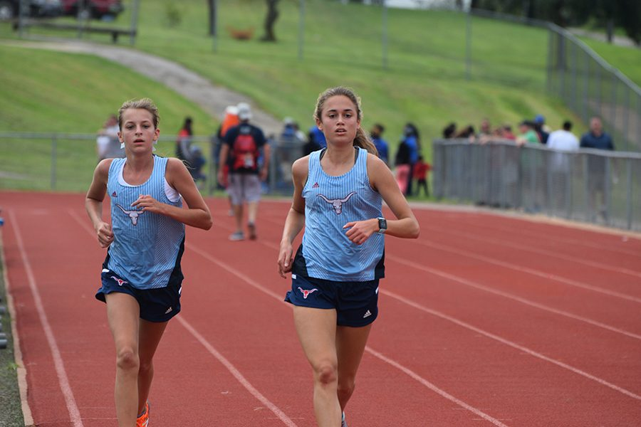 Sophomore Kate Yates and junior Emily Sipp compete in time trials Aug. 31.
