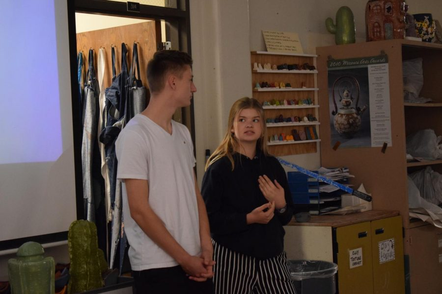 Exchange students Luke Stöckelmann and Celina Henn stand beside the projector giving a presentation. Hen and her classmates traveled to St. Louis for two weeks and departed Saturday Oct. 12.
