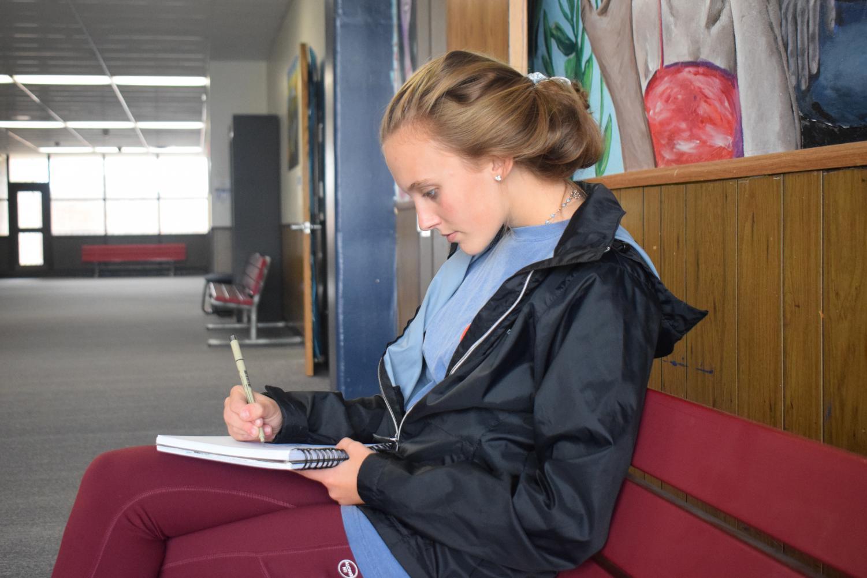 Freshman Ashlynn Gillespie reads about algebra outside of her class.