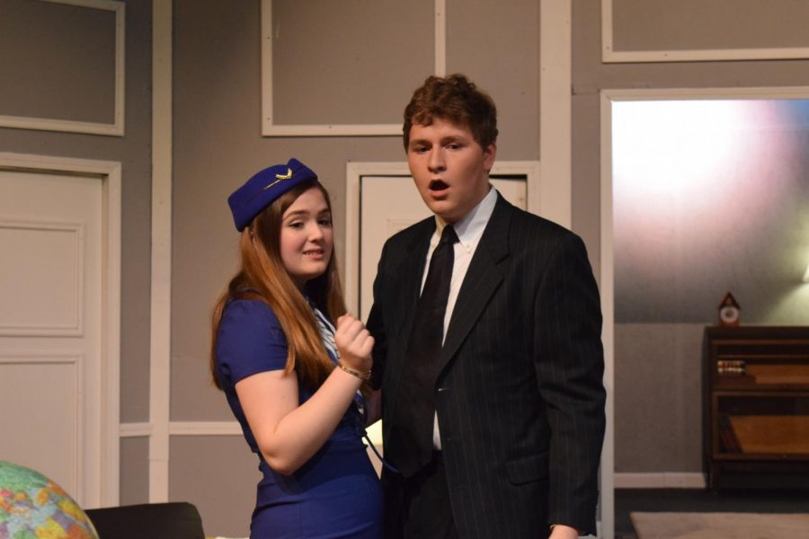 "Junior Clare Weaver and senior Dennis McMorrow portray Gabriella and Bernard, respectively, in a scene from ""Boeing Boeing."""