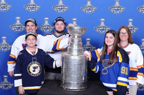Play Gloria: Students and staff with the Stanley Cup