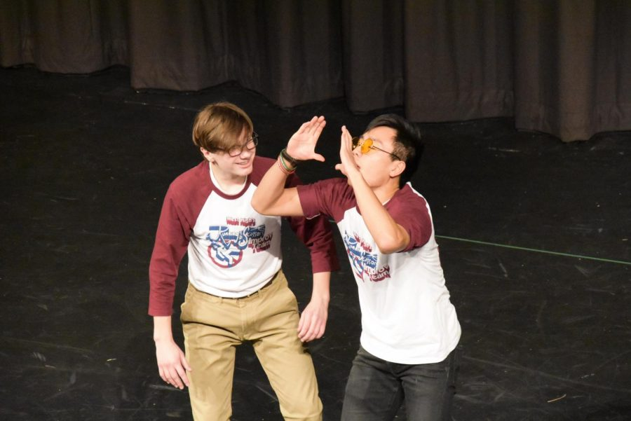 Bathed in spotlights, senior Jon Ma and freshman Brian Isele entertain the audience at the improv show Friday, Oct. 25.