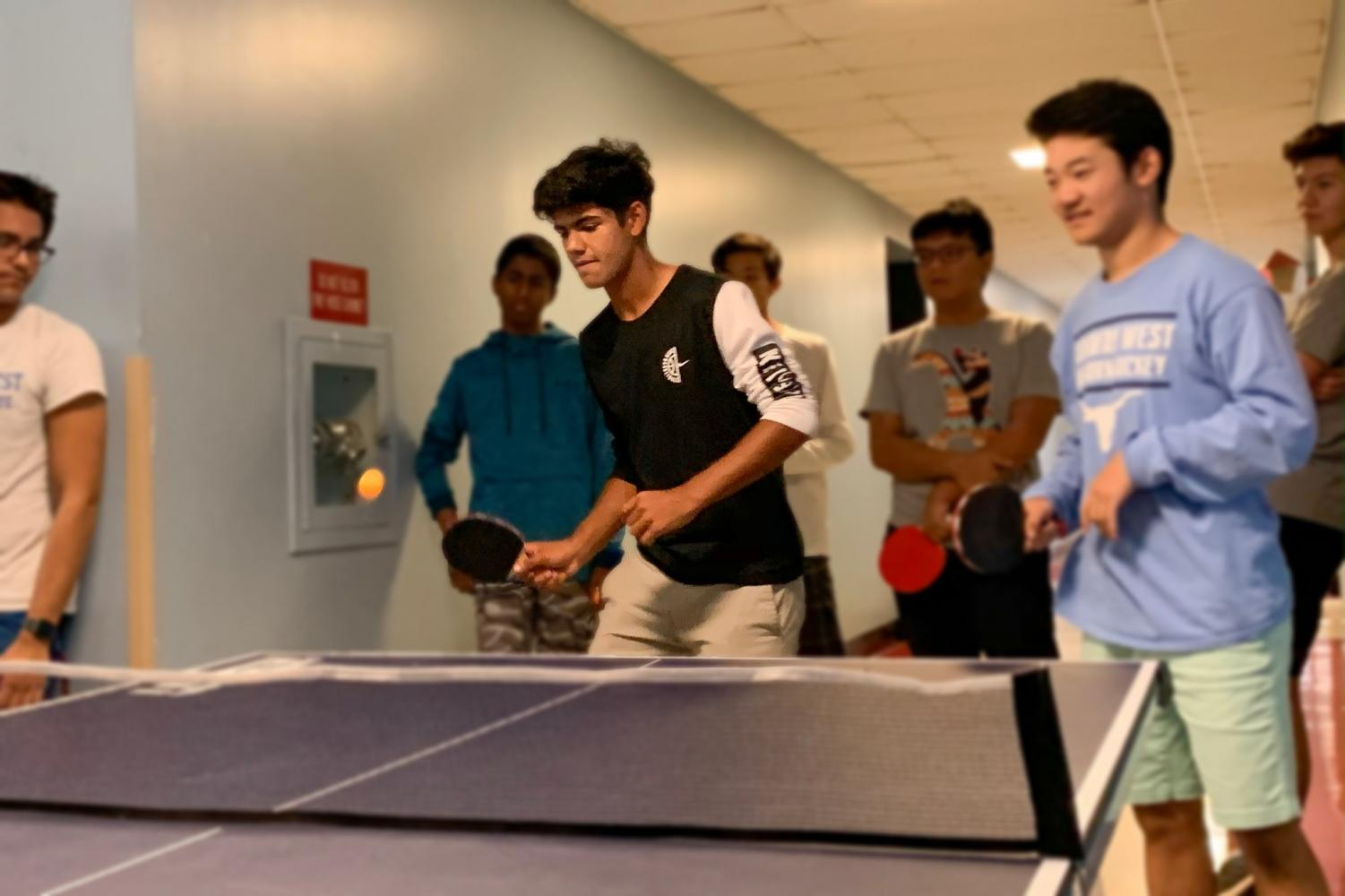 """Eyes focused on the ping pong ball, junior Ali-Raza Rizvi serves to his opponents. Before the first official meeting of Table Tennis Club, Rizvi met up with club co-founder and junior Skyler Ji to play for fun. """"Ping pong is a sport of precision and accuracy; I thought this describes me perfectly,"""" Rizvi said. """"This club provides a fun environment where everyone can enjoy playing competitively and recreationally."""""""