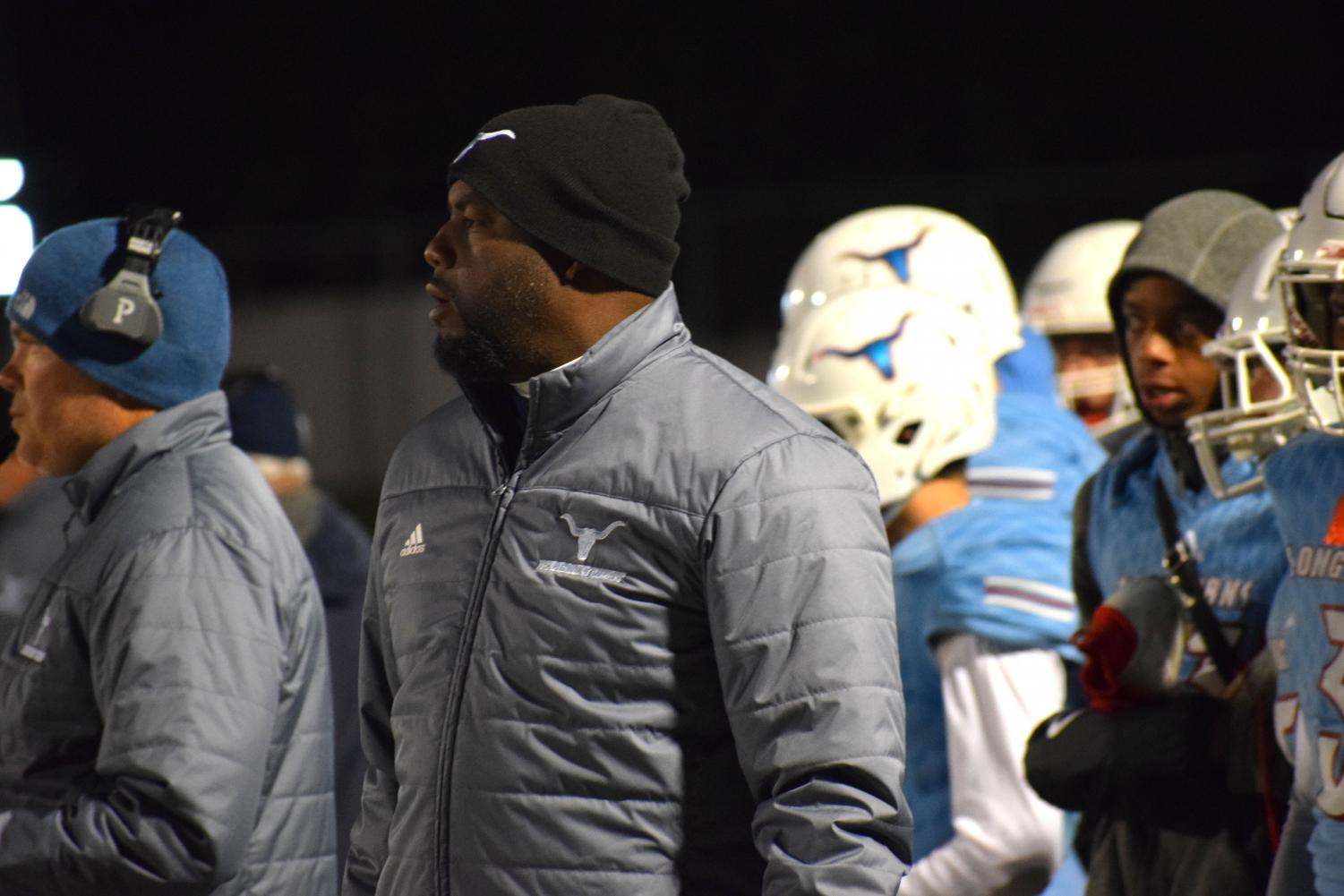 """Leading the running backs, coach Melvin Bethany uses his own experience playing football to help Varsity football against Ladue High school. Bethany has been the running back coach for the last 11 years. """"He does a great job teaching the game,"""" sophomore Tyree Simms said. """"He really wants to help players get better and meet their goals."""""""