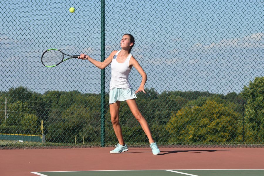 "Rallying for the point, junior Lindsey Anstrom plays during girls tennis senior night Oct. 1. Both JV and varsity defeated Eureka while honoring their seniors. ""The season went by really quickly. This was the best season for me because I had my best friend, Gabrielle Oliver, as my partner, and we would just have fun on the court,"" Anstrom said. ""We would worry about the score, but we wouldn't stress if we were losing. We did this handshake after each play, no matter if we won or lost the point; it was just a sign of sportsmanship and that we trusted each other."""