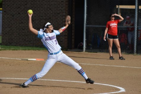 "With 14 years of experience, junior Dorothy Wunderlich pitches the softball to her opponent. During the season, Wunderlich's bone hit against her hip labrum and re-tore the muscle. ""I played the entire season and had surgery the Tuesday after [the last game]. Loving the sport keeps me going [through the injuries]; I would love to play softball in college,"" Wunderlinch said. ""I love my teammates, and they are really supportive about me being injured."""