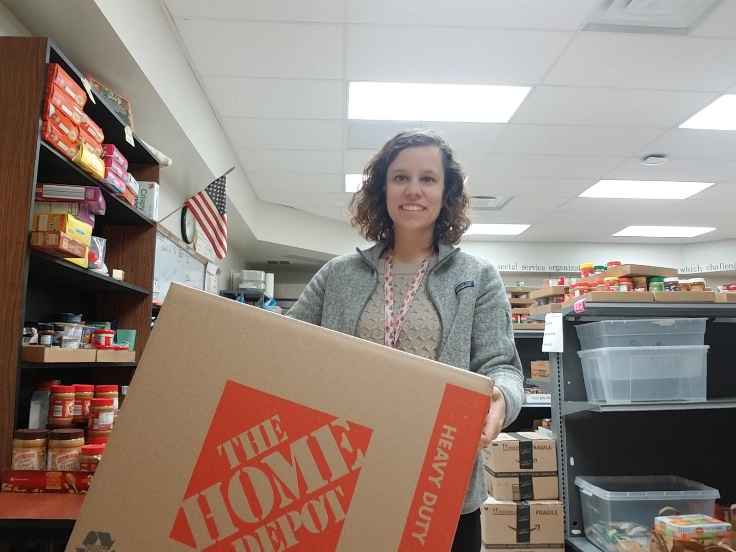 """Parkway Food Pantry Social Worker Jess Buettner delivers Thanksgiving items to families in need Nov.19. Approximately eight schools in the Parkway District rallied around to help with this event. """"All the things that you think of in your normal thanksgiving dinner we include so that it's a little less that families have to worry about,"""" Buettner said."""