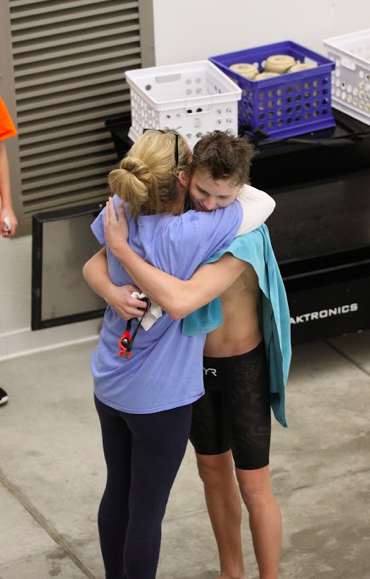Bonnett embraces assistant coach Mary Beth Wilson during the Conference Championship swim meet at Pattonville High School on Nov 6. Bonnett's hard work throughout the season resulted in Conference first place swims in the 200 IM, 500 Freestyle and 400 Freestyle relay.