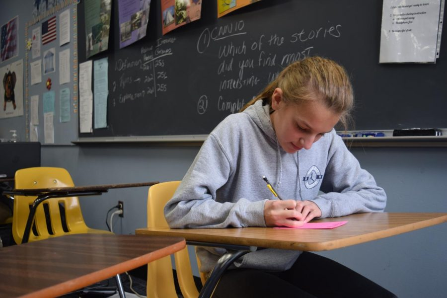 Writing+a+Teacher+of+the+Year+nomination+note+in+World+History+teacher+Amy+Thornhill%E2%80%99s+class%2C+sophomore+Kate+Yates+gets+the+opportunity+to+thank+her+teacher+of+choice%2C+as+well+as+possibly+nominate+them+as+Teacher+of+the+Year.+%E2%80%9C%5BTeachers%5D+spend+so+much+time+and+effort+to+teach+us+and+make+sure+we+understand+the+content.+We+need+a+way+to+appreciate+them+so+they+know+we+are+thankful+for+everything+they+do+for+us%2C%E2%80%9D+Yates+said.+%E2%80%9CWe+should+%5Bhave+a+say%5D+because+we+spend+the+most+time+with+%5Bteachers%5D.+We+are+the+ones+in+their+classes+all+day.%E2%80%9D