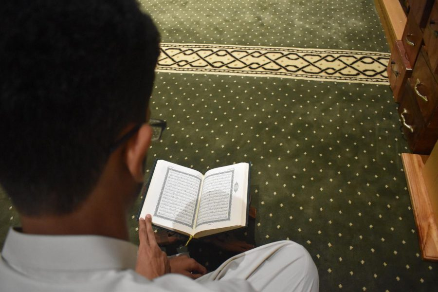 Sophomore Waleed Abdulla reads passages of the Qur'an before prayer.