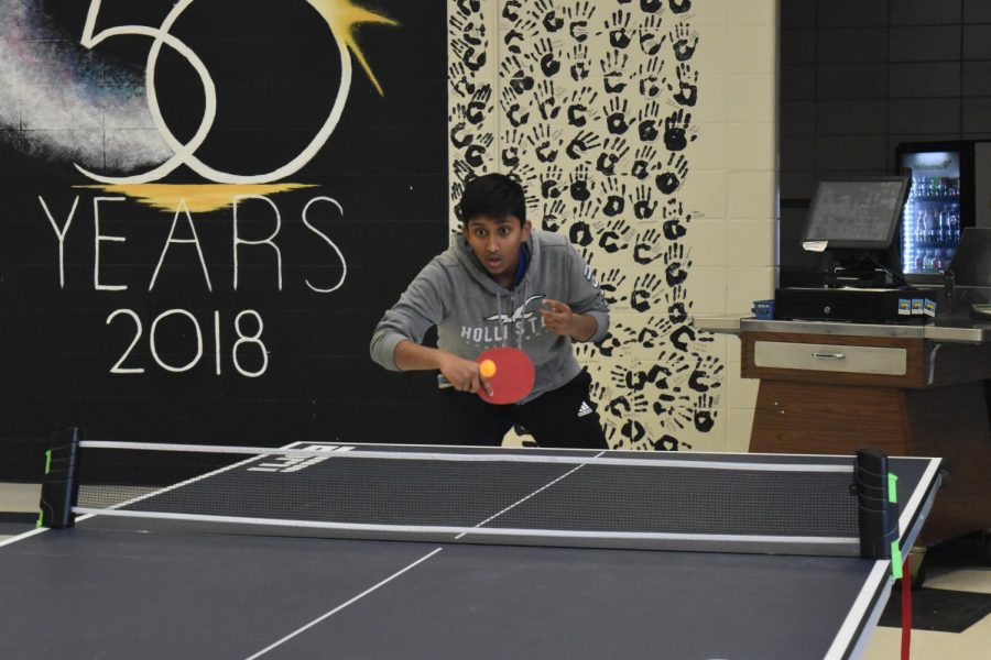 Freshman Rohan Daggubati engages in a ping pong match against junior Sri Jaladi. Daggubati has played ping pong for two years and with the Ping Pong Club every Tuesday.
