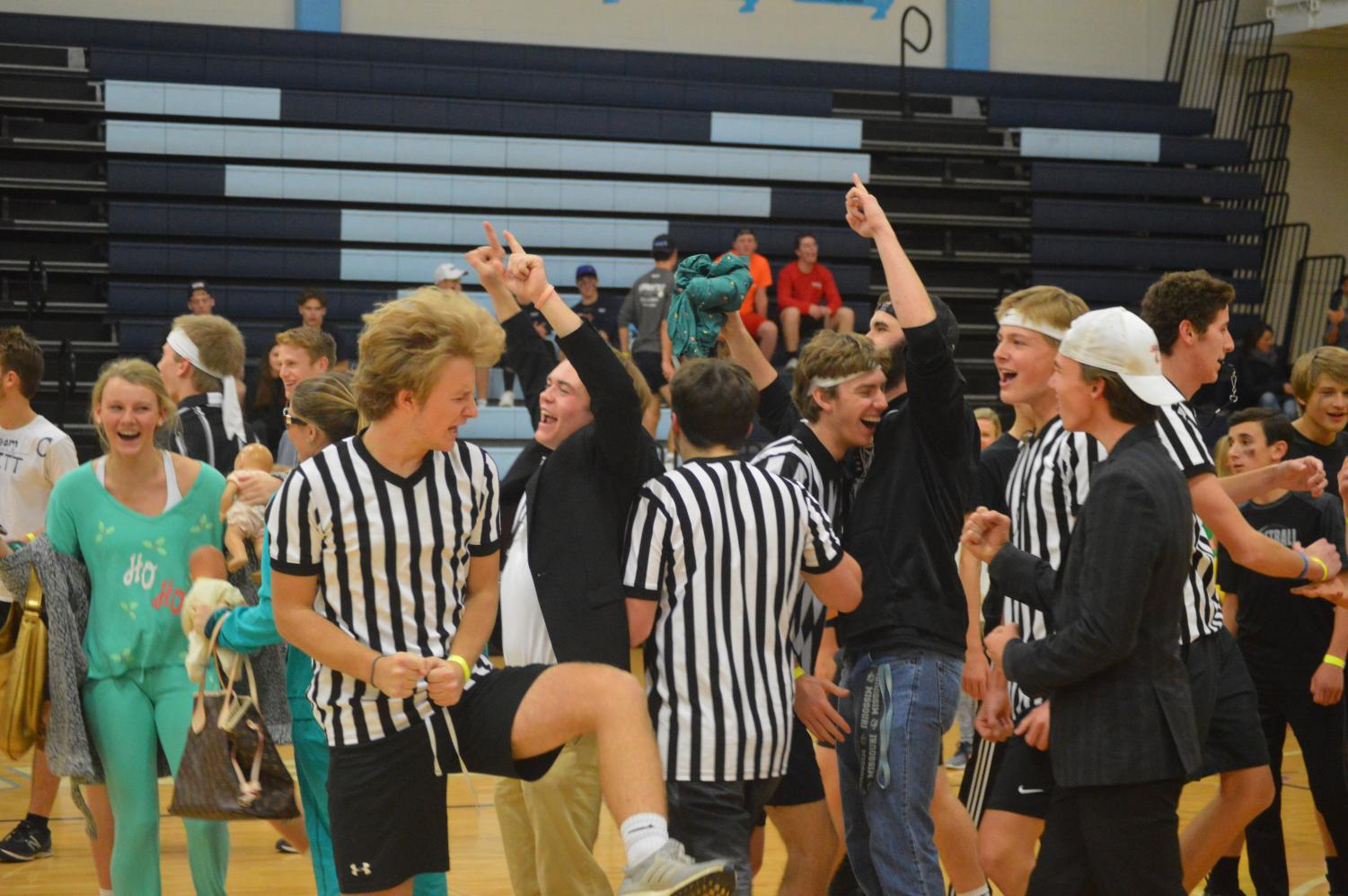 Celebrating the dodgeball victory, the Zebras coach, senior Nick Boland raises two fists in the air. The Zebras later went on to win the whole tournament.