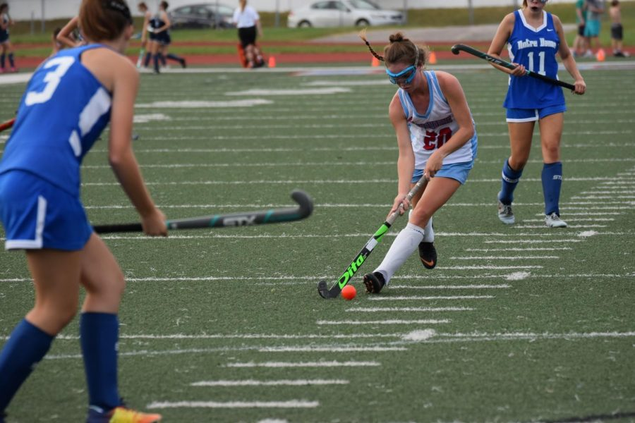 Senior forward Callie Hummel dribbles with the ball on her stick, trying to advance or find an optimal passing location. The varsity team beat Notre Dame 4-1 September 25th, with Hummel scoring one of the four goals.