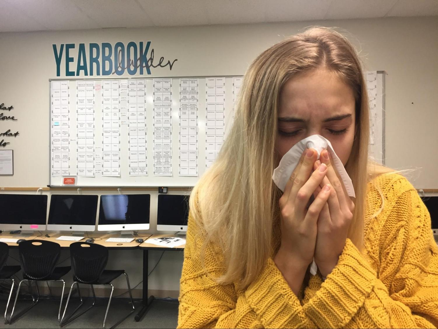 """Clearing her nasal passages, sickly senior Susie Seidel expels mucus in hopes of relieving her symptoms. Seidel is currently suffering from the ongoing plague, suspected to be Senioritis, impacting the senior class. """"I had a quiz this morning so I came to school thinking I could muster enough strength to make it through the day,"""" Seidel said. """"After I finished my quiz, I realized I was no match for the deadly disease and quickly left school so I wouldn't infect others. I guess you could say I was caring, I removed myself from school to ensure the safety of others."""