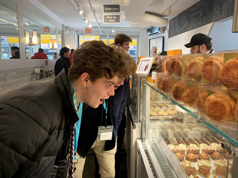 Eyeing+up+breakfast+options%2C+seniors+Nolan+Barbre+and+Jake+Juenger+take+in+the+sights+and+smells+of+Dominique+Ansel+Bakery+during+their+first+morning+in+New+York+City.+Marketing+students+go+on+an+annual+trip+to+tour+New+York%E2%80%99s+major+businesses+and+learn+about+marketing+strategies.+%E2%80%9CI+got+a+piece+of+chocolate+cake+for+breakfast%2C+which+was+a+pretty+great+start+to+the+day%2C%E2%80%9D+Barbre+said.+%E2%80%9CEverything+in+New+York+is+so+much+fun+and+totally+different+than+an+everyday+routine+back+at+home.%E2%80%9D+