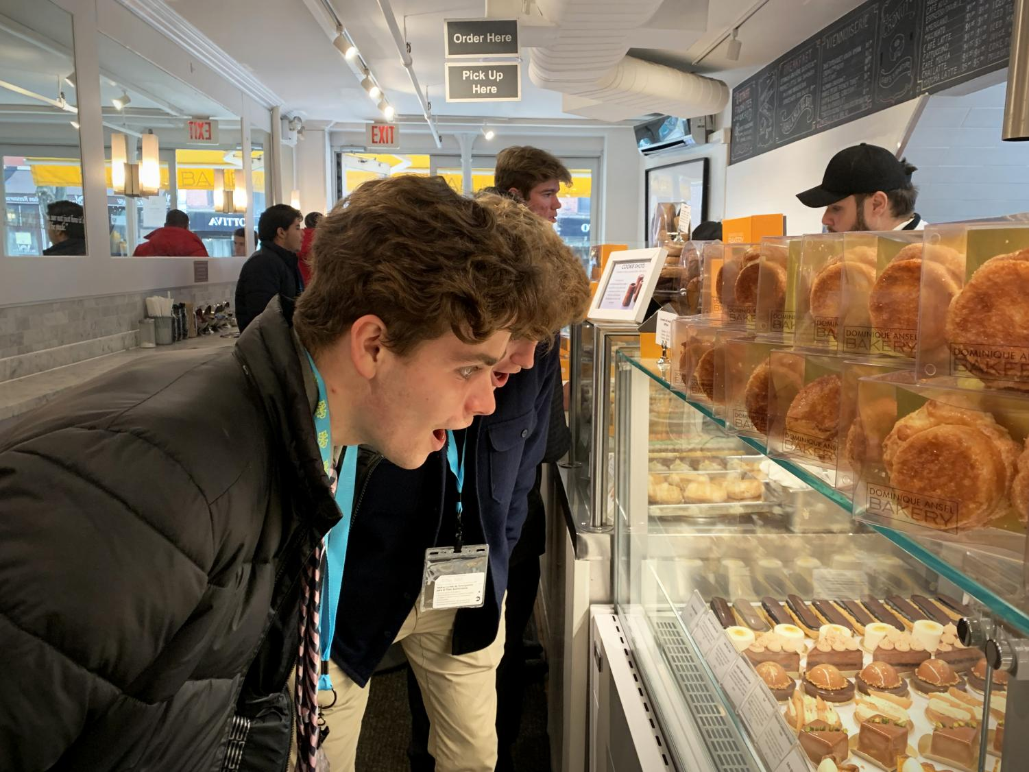 "Eyeing up breakfast options, seniors Nolan Barbre and Jake Juenger take in the sights and smells of Dominique Ansel Bakery during their first morning in New York City. Marketing students go on an annual trip to tour New York's major businesses and learn about marketing strategies. ""I got a piece of chocolate cake for breakfast, which was a pretty great start to the day,"" Barbre said. ""Everything in New York is so much fun and totally different than an everyday routine back at home."""