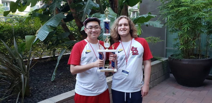 "After winning their competition, seniors Jason Yang and Ben Goff stand outside the venue, holding their trophy. The competition lasted for three days from Sept. 13 to Sept. 15. ""This was an amazing experience, and I am glad we were able to compete,"" Goff said. ""I just like being able to come up with unique ideas and being able to design a robot and put them to test and see which ideas worked and which ones didn't."""