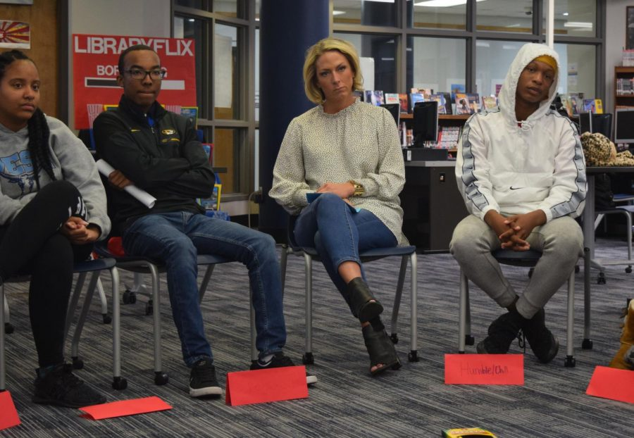 "Junior Tiye' Hyler, senior TJ Fleming, guidance counselor Jen Skalski and freshman Brian Campbell sit and listen to students talk during a restorative circle. In the library, African American students discuss with teachers and others about what it is like to be a black student at a predominantly white school. ""It can be tricky because you don't want to offend anyone, you want everyone to understand that you come with a good heart and your goal is to help them succeed,"" Perez said."