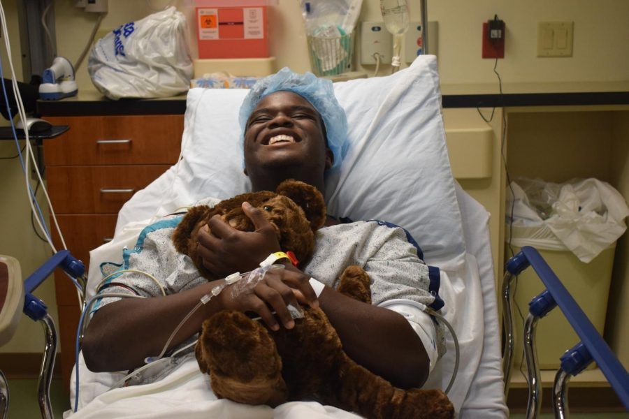 Smiling+before+surgery%2C+junior+Tim+Nelson+holds+a+teddy+bear.+Nelson+was+excited+to+undergo+surgery+so+that+he+could+begin+the+long+recovery+process.+%E2%80%9CAfter+the+pain+goes+away%2C+I+know+%5Bthe++recovery+process%5D+will+be+easy%2C%E2%80%9D+Nelson+said.+%E2%80%9CI+just+need+to+have+patience%2C+and+that%27s+kind+of+something+I+don%27t+have+all+the+time.%E2%80%9D